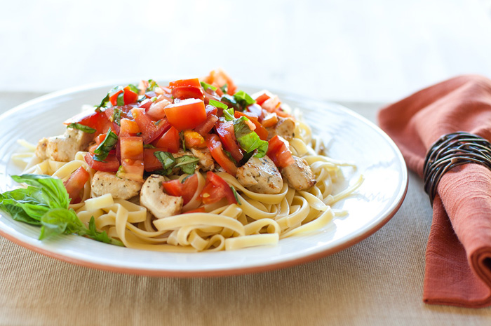 Chicken and Pasta with Tomato Basil Garnish